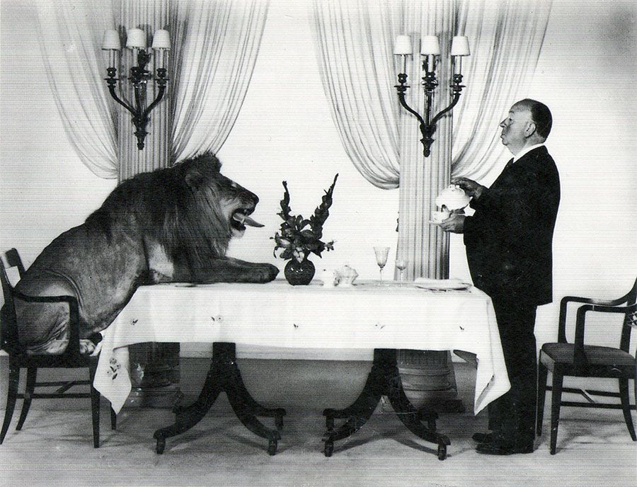 Alfred-Hitchcock-serving-some-tea-to-Leo-the-Lion-the-mascot-for-the-Hollywood-film-studio-MGM